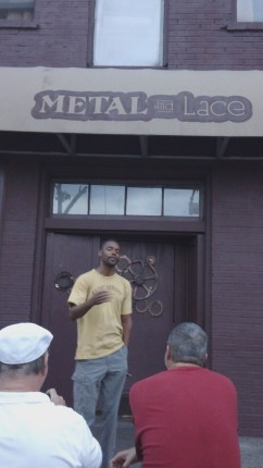 Ajari Eniyi participating in a special post-SXSW outdoor read at Metal and Lace Club.